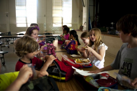 Children at lunch table food allergies