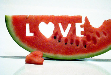 "Watermelon with ""Love"" carved into it natural sunscreen"