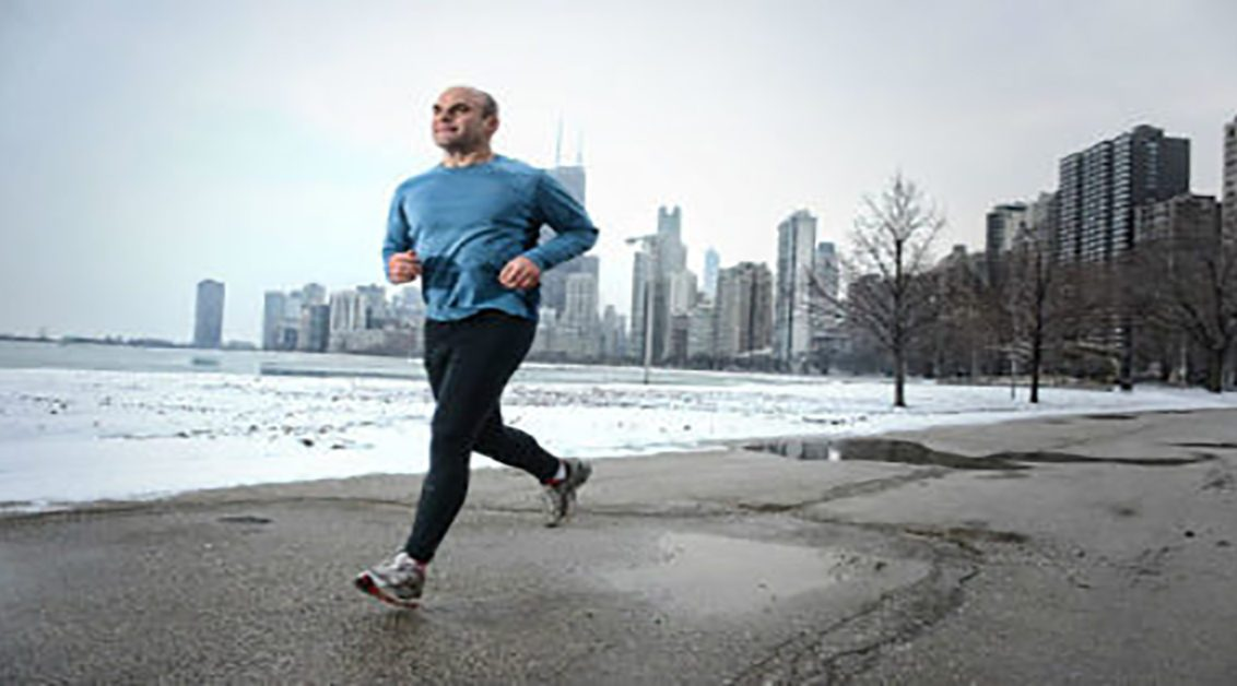 Man jogging with city scape in the background
