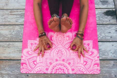 woman stretching on pink luxury yoga mat